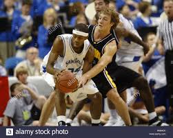 Iowa Hawkeyes Adam Haluska (R) gets a hand on the basketball being handled  by Saint Louis University Billikens Tommie Liddell in the first half at the  Savvis Center in St. Louis on