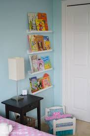 Alternative To A Book Shelf Display With A Wall Of Books