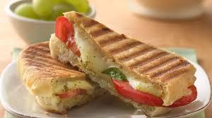 pesto mozzarella and tomato panini