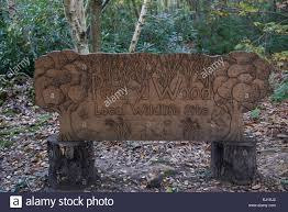 Carved wooden sign for Perry Wood in Kent England Stock Photo: 62737754 -  Alamy