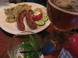homemade bratwurst served with sour