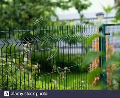 Metal Mesh Garden Fence Stock Photo Alamy