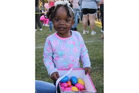 PHOTOS: Church at the Cross' Egg Hunt Under The Lights - Abigail Peterson,  2, enjoyed filling her Easter basket. | West Orange Times & Windermere  Observer