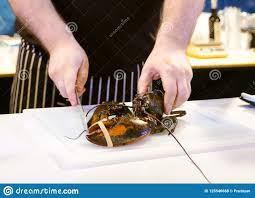 Cooking Lobster, Chef Cutting Lobster ...