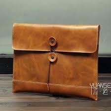 leather clutch bag with shoulder strap