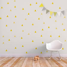 Love This Randomized Triangle Accent Wall With The Soft Yellow Accented Triangles Triangle Decals Baby Wall Decals Wall Decals Yellow Wall Decals Triangles