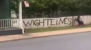 Spray Painter Writes Wighte Lives Matter On Picket Fence
