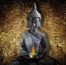 buddha statue sitting candle flame