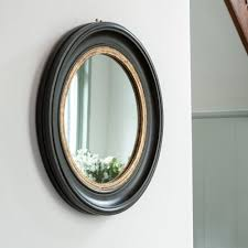 round mirror antique black with gold