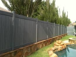 Vinyl Fence And Retaining Wall Backyard Fences Fence Design Backyard