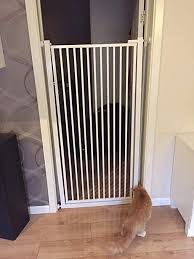 Amazon Com Zaq Extra Tall Pet Gate For Dogs Cats Baby Barrier For Doorways Stair Hallway White Metal Indoor Safety Gates Size Width 125 128cm Home Kitchen