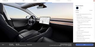 tesla removes auto dimming side mirrors
