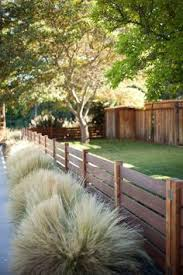 A 4 Foot Horizontal Fence With Rails Embedded Into The Posts Fence Design Wood Fence Design Backyard Fences