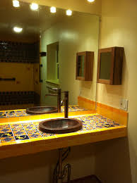 bathroom copper sink on a mexican tile