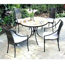 small round patio table and chairs