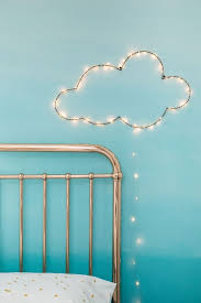 17 Twinkly Ways To Light Up Your Home With Christmas Fairy Lights Fairy Lights Diy Diy Clouds Christmas Fairy Lights
