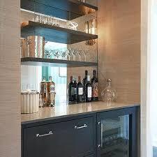 butler pantry with mirrored backsplash
