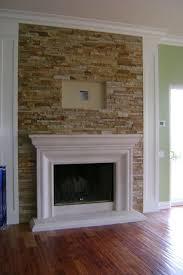 tv mounting over fireplace with images