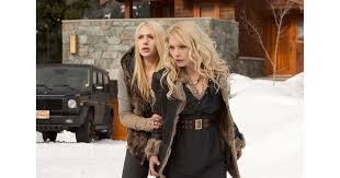 Casey LaBow as Kate and MyAnna Buring as Tanya in Breaking Dawn ...