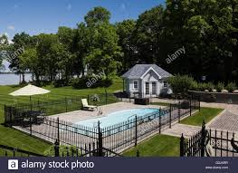 In Ground Pool Surrounded Black Wrought Iron Fence In Landscaped Stock Photo Alamy