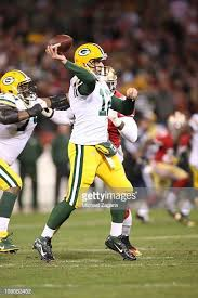Aaron Rogers of the Green Bay Packers passes during the game against... | Aaron  rogers, Green bay, Green bay packers