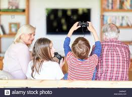Kids And Grandparents With Game Console In Gaming Competition On Smart Tv Stock Photo Alamy
