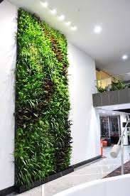 green wall transforms office block in