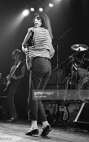 Patti Smith performs on stage, with Ivan Kral behind, at Jaap Eden... |  Patti smith, Patti, Music film