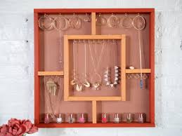 build a wall hanging jewelry rack diy