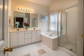 glue a frameless mirror to drywall