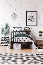 Scandinavian Style Kid S Bedroom With Cactus Pillow On Pouf Next Stock Photo Picture And Royalty Free Image Image 90323561