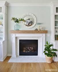 fireplace with surround with beam above