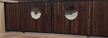 Ornamental Iron And Wood Wagon Wheel Electric Gate American Fence Concepts