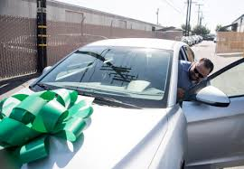 Iraq War Vet Who Rode The Bus To Do Volunteer Work Surprised With A New Car At Costa Mesa Repair Shop Orange County Register