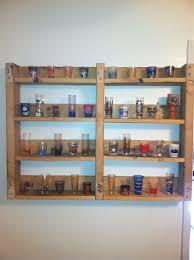 a shot glass shelf from a pallet