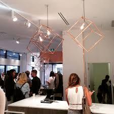 this copper cube pendant light creates