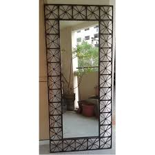 large mirror with metal frame rusty