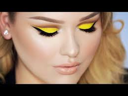 yellow cut crease makeup with lips