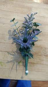 Sea Holly boutineer | Holly wedding, Wedding flowers, Sea holly