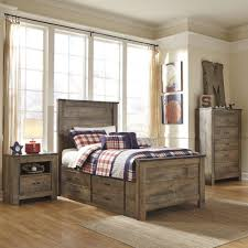 Trinell Panel Bed W Storage Bedroom Set Adams Furniture