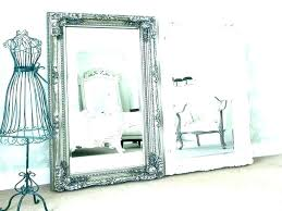 antique white ornate mirror