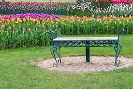 park bench in tulip flower garden stock