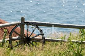 Old Wagon Wheel Against Fence Stock Photos Freeimages Com
