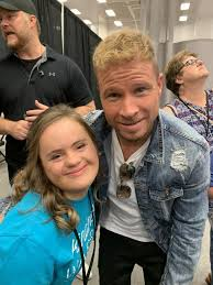 Brian Littrell poses with a member of Down Syndrome of Louisville | |  wdrb.com