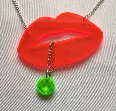 red lips and neon green smiley acid