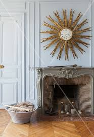 golden sunburst mirror on wall above