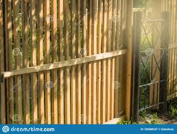 Rustic New Wooden Fence With Black Metal Posts And Gates Garden And Vegetable Garden Fence On A Sunny Summer Day Against The Stock Image Image Of Architecture Vegetable 156608247
