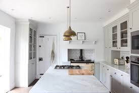 a cooktop and wall oven in the kitchen