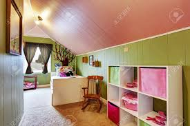 Kids Room With Vaulted Ceiling In Contrast Green And Pink Colors Stock Photo Picture And Royalty Free Image Image 30283003