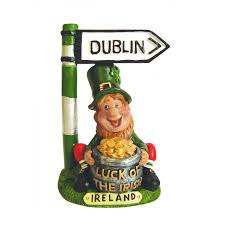 gold and dublin road sign ornamental statue